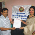 Mrs. Sucharita R. Hegde, Trustee and Managing Editor, OIOP, presents the OIOP Club membership certificate to Principal Dixit.