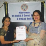 Mrs. Sucharita R. Hegde, OIOP Foundation Trustee and Managing Editor, presenting the OIOP Club membership certificate to the Principal Mrs. Asha R. Joshi