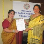 Mrs. Hegde presenting the OIOP Club membership certificate to the Principal Dr. Uma Rele