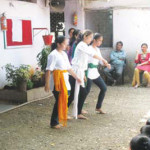 Students performing a dance on the occassion