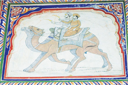 A wall mural of two nobles engaged in a camel race in the desert