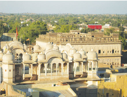 Mandawa Castle:  Seen from the battlement of the castle are the living quarters of the current owner Shri Bhim Singhji. Beyond lies the town of Mandawa