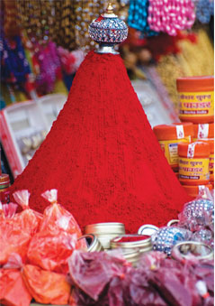 A mountain of kumkum in a sidewalk stall at Haridwar