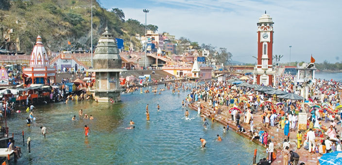 The bathing ghats and in the distance, the Clock Tower, at Har ki Pauri