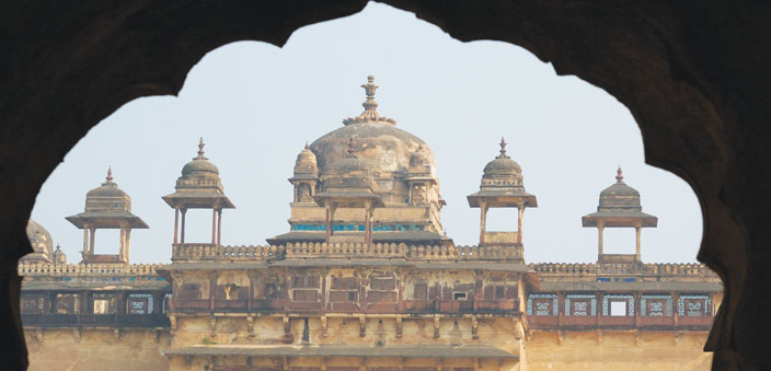 Domes of a palace in Orchha, framed in an arch