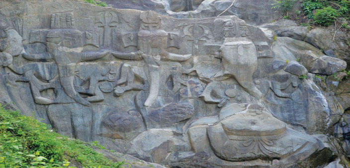 Ganesha that seems to bathe in the waterfall when it rains; at Unakoti