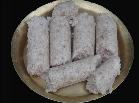 The delicious pitha is made in bamboo tubes