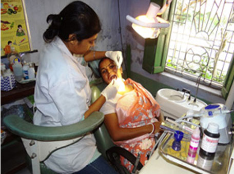 A dental check-up in progress at Swarupnagar PHC