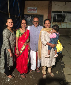 Tanvi (extreme right) with her two-year-old daughter, parents and sister
