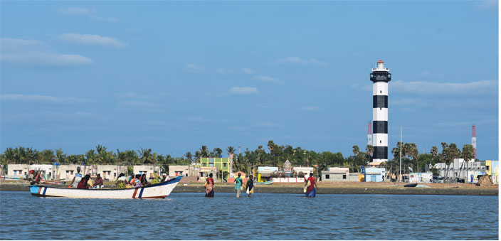 The Lighthouse of Pulicat; this white and blue structure, stands tall, warning of shoals near the coast