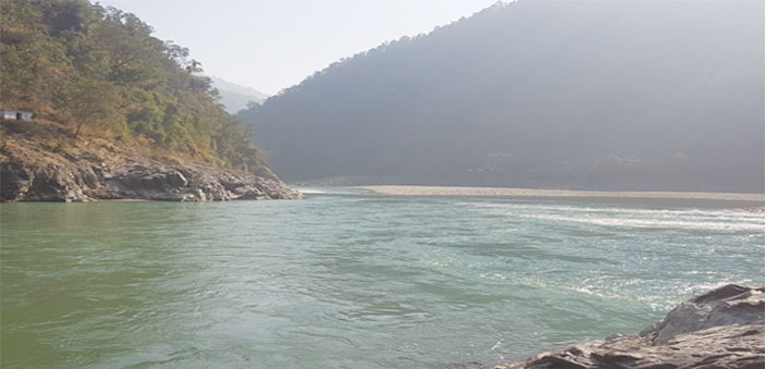 The confluence of rivers Sarayu and Kali; the opposite side is Nepal